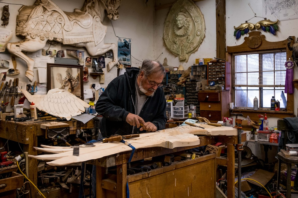 Image of Joe Leonard working on a carving at his workshop table
