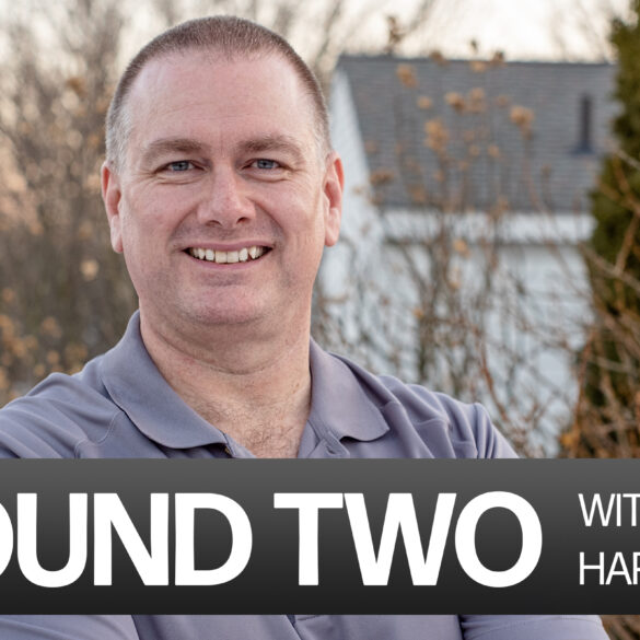 """Head shot of Tom Hardesty, a white man with short hair in a grey golf polo with the caption """"Round Two with Tom Hardesty"""""""