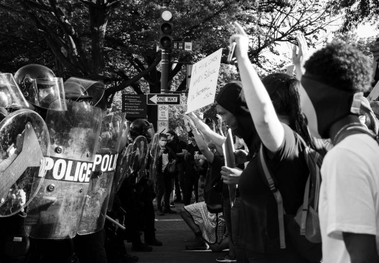 Image of protesters and police