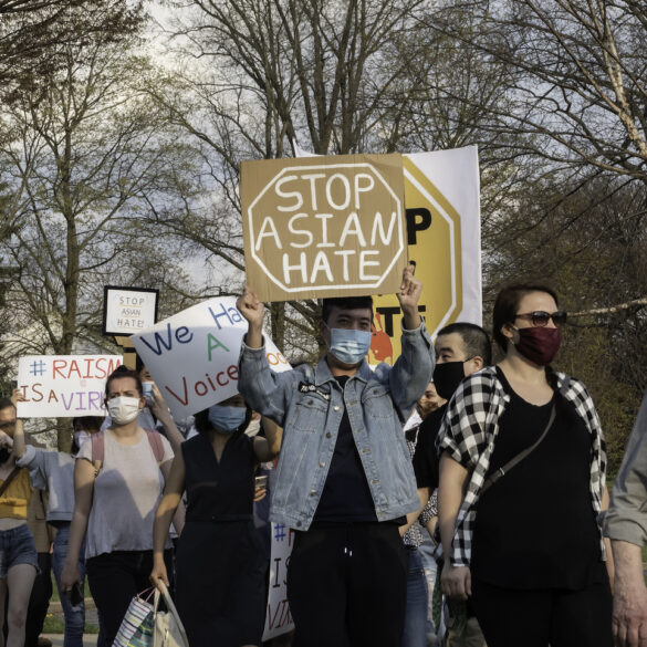 Image of demonstrators marching against anti-Asian racism