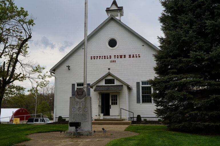Image of the Suffield Town Hall building on a cloudy day