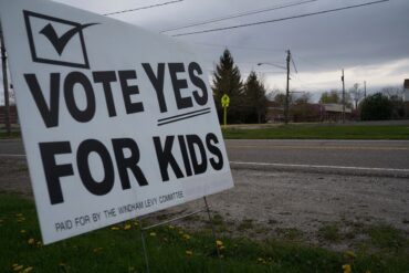 """image of a sign that says """"vote yes for kids"""" in front of Windham schools"""