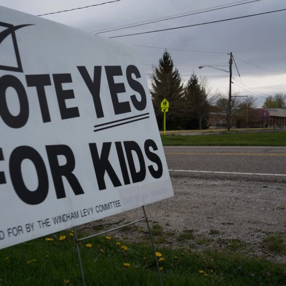 "image of a sign that says ""vote yes for kids"" in front of Windham schools"