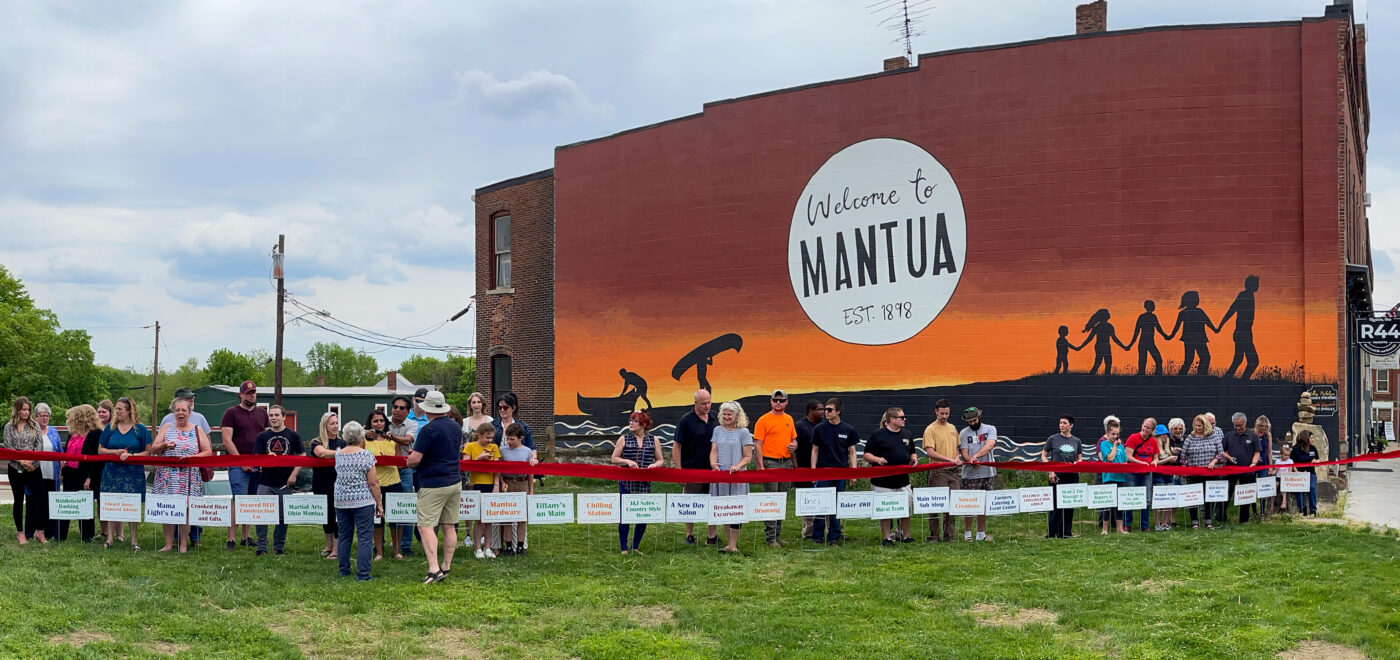 Image of Mantua's downtown business leaders next to the mural