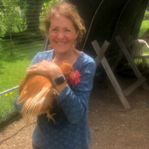 Image of Streetsboro resident Margaret Gotschall posing with her chicken, Stacy