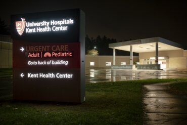 Image of the front of a hospital facility at night