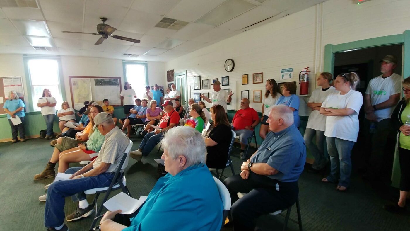 Image of dozens of residents at Freedom Town Hall