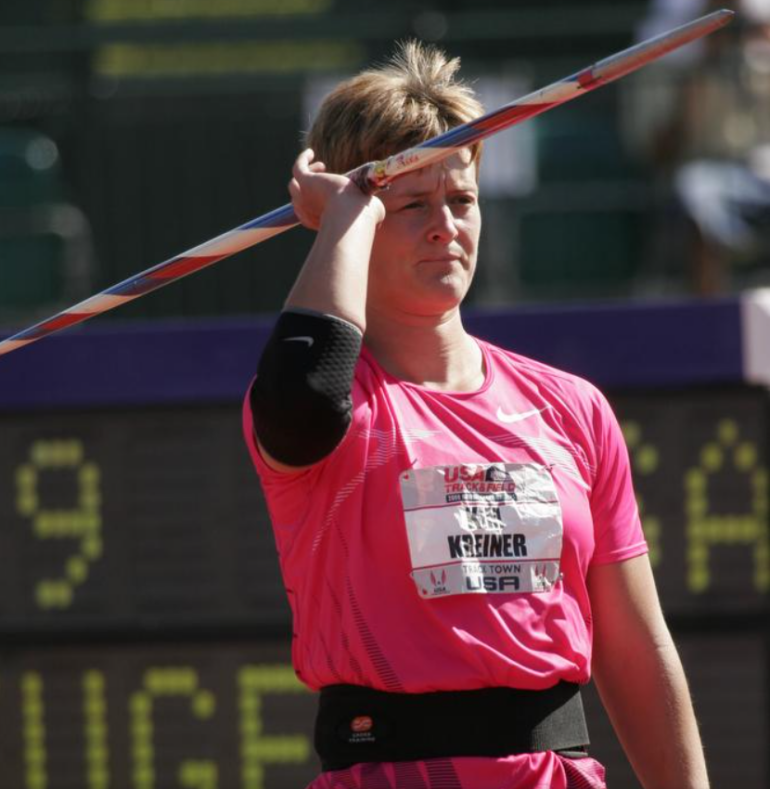 Image of a woman in a pink track and field shirt preparing to throw a javelin
