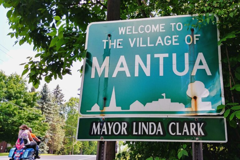 A welcome sign for the Village of Mantua, Ohio, including the name of the mayor, Linda Clark
